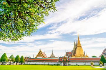 Wall Mural - Emerald buddha temple golden pagoda blue sky with cloud sightseeing in Bangkok