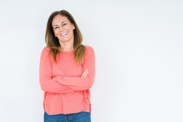 Beautiful middle age woman over isolated background happy face smiling with crossed arms looking at...