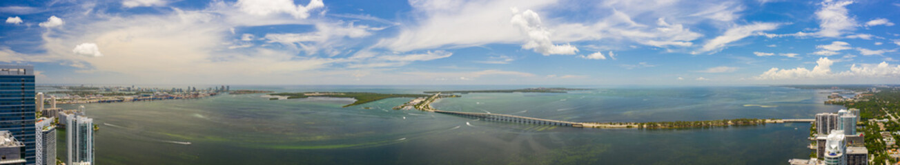 Wall Mural - Beautiful aerial panorama of Brickell Bay. Scene includes water bridges and harbor overlooking Key Biscayne
