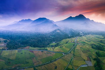 high mountain aerial photo where the red sky and sunrise are very beautiful and spoil the eyes above the rice fields in bengkulu, indonesia, asia