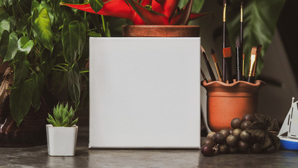a blank square canvas for design mockup template in the garden.