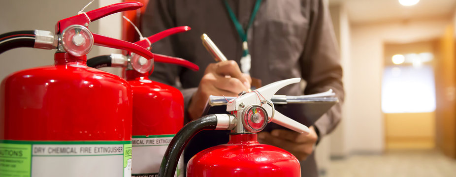 Fire extinguishers, Engineers are checking fire extinguishers.