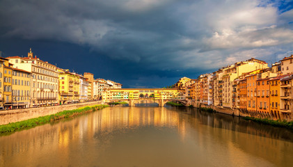 View of medieval stone bridge Ponte Vecchio over Arno river in Florence, Tuscany, Italy. Beautiful Florence after the rain. Florence architecture and landmark.