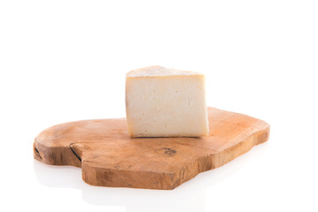 Goat cheese on cutting board