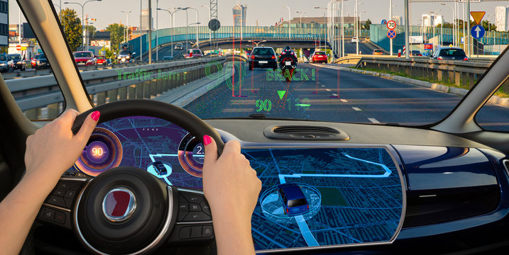 woman driving a car equipped with active safety systems and HUD