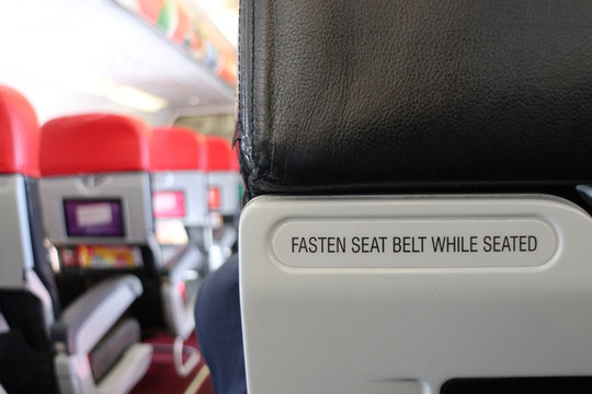 Warning Signs on Airplane Fasten Seat Belt While Seated