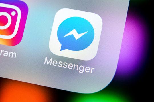 Sankt-Petersburg, Russia, March 22, 2018: Facebook messenger application icon on Apple iPhone X screen close-up. Facebook messenger app icon. Online internet social media network. Social media app