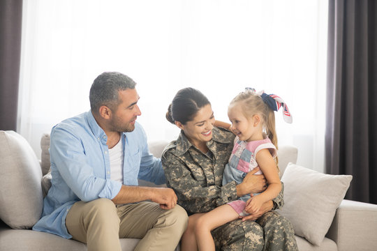 Family feeling happy while reuniting at home