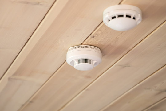 smoke and carbon monoxide detectors in a wooden house