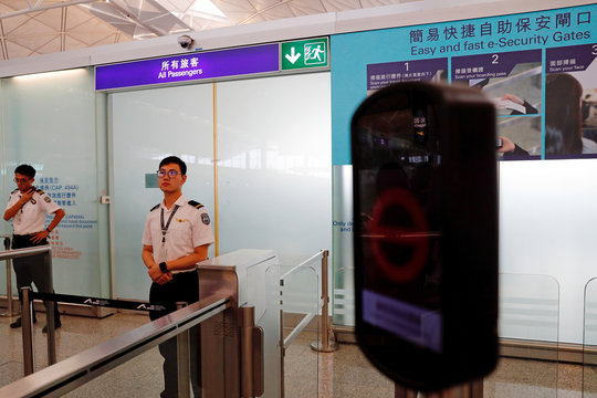 Security gates are temporarily closed as anti-extradition bill protesters hold a mass demonstration after a woman was shot in the eye during a protest at Hong Kong International Airport, In Hong Kong