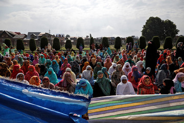 Kashmiri women offer Eid-al-Adha prayers at a mosque during restrictions after the scrapping of the special constitutional status for Kashmir by the Indian government, in Srinagar