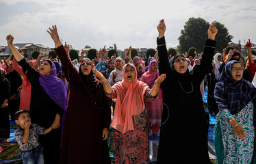 Kashmiri women shout pro-freedom slogans before offering the Eid-al-Adha prayers at a mosque during restrictions after the scrapping of the special constitutional status for Kashmir by the Indian government, in Srinagar