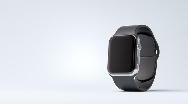 Smart watch with black strap on the white table with copy space at the left side.