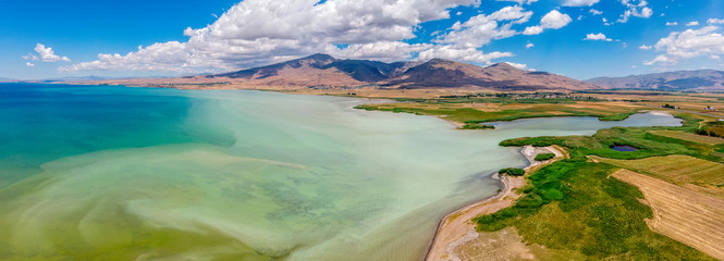 Aerial view of Lake Van the largest lake in Turkey, lies in the far east of that country in the provinces of Van and Bitlis. Fields and cliffs overlooking the crystal clear waters