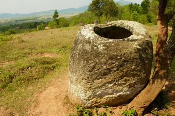Ancient stone jar in a Plain of Jars (Site #2) near Phonsavan,  Xienghouang province, Laos..