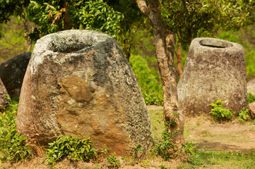 Ancient stone jars in a Plain of Jars (Site #2) near Phonsavan,  Xienghouang province, Laos..