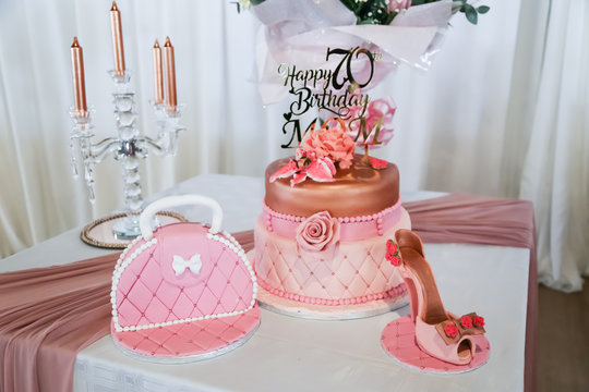 Happy 70th Birthday Mom In Rose Gold On Birthday Cake With Shoe And Handbag Fresh Flowers Buy This Stock Photo And Explore Similar Images At Adobe Stock Adobe Stock