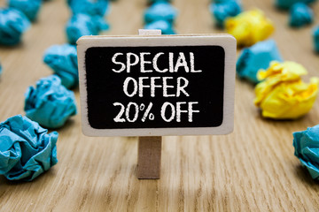 Text sign showing Special Offer 20 Off. Conceptual photo Discounts promotion Sales Retail Marketing Offer Paperclip hold written chalkboard behind paper lumps on woody deck