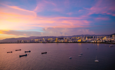 Sanya town evening cityscape, view from Phoenix island on Hainan Island of China