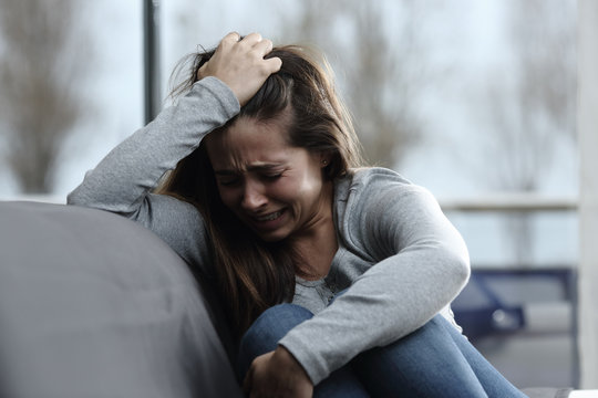 Sad girl complaining and crying at home