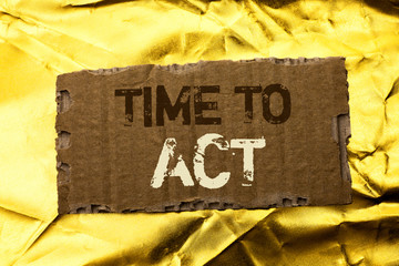 Word writing text Time To Act. Business concept for Action Moment Strategy Deadline Perform Start Effort Acting written tear Cardboard Piece the Golden textured background.