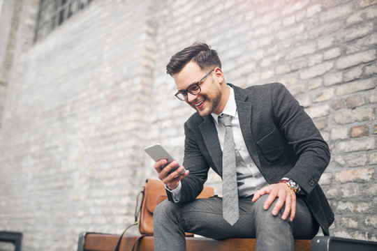 Businessman checking phone on pause