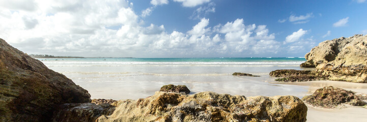 Panorama of a wild beach in the sandy bay of the blue tropical sea