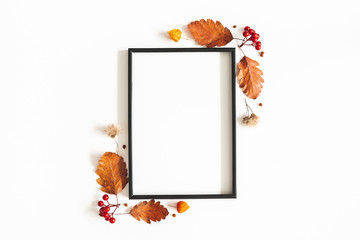 Autumn composition. Photo frame, flowers, leaves on white background. Autumn, fall, thanksgiving...
