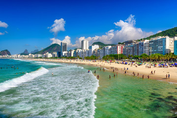 Fotobehang - Copacabana beach and Leme beach in Rio de Janeiro, Brazil. Copacabana beach is the most famous beach in Rio de Janeiro. Sunny cityscape of Rio de Janeiro