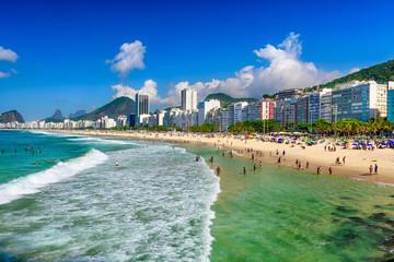 Fototapete - Copacabana beach and Leme beach in Rio de Janeiro, Brazil. Copacabana beach is the most famous beach in Rio de Janeiro. Sunny cityscape of Rio de Janeiro