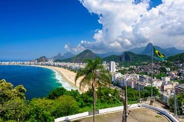 Fototapete - Copacabana beach in Rio de Janeiro, Brazil. Copacabana beach is the most famous beach of Rio de Janeiro, Brazil. Skyline of Rio de Janeiro with flag of Brazil