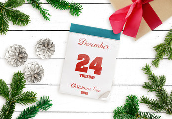 top view of tear-off calendar on December 24 Christmas Eve 2019 on white wooden table