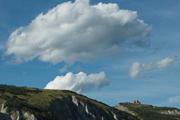 Nice clouds above the Schneealpenhaus on Schneealpe in Lower Austria, Europe