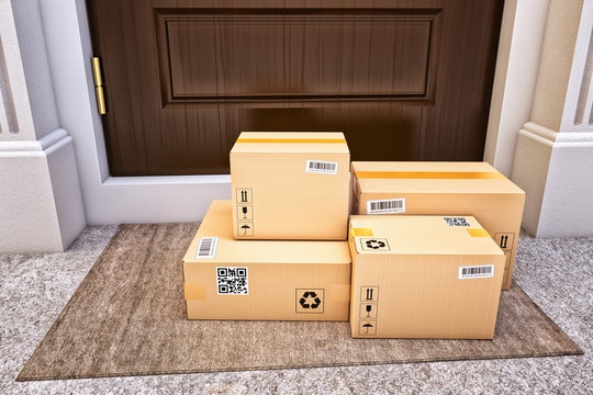 Internet shopping, online purchases, e-commerce and express package door-to-door delivery service concept, cardboard boxes on the door mat near the entrance door