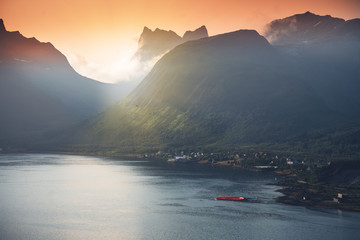 Wall Mural - Beautiful vibrant landscape, pink sunset by the sea on Senja island, the beauty of nature in northern Norway
