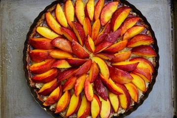 Homemade vegan fruit tart with nectarines and frangipane almond cream