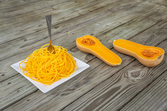 Butternut squash noodles with fork stuck in the middle of the pasta.