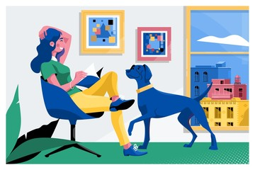 Girl reading a book and dog sitting on the armchair