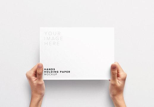 Hands Holding Paper Mockup