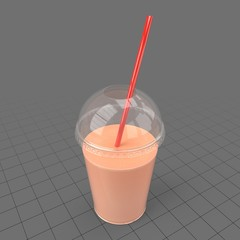 Glass of juice with straw