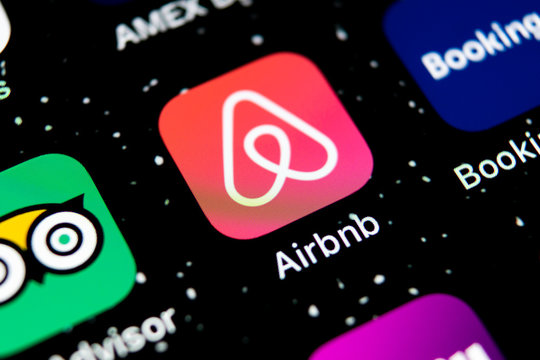 Sankt-Petersburg, Russia, February 3, 2019: Airbnb application icon on Apple iPhone X screen close-up. Airbnb app icon. Airbnb.com is online website for booking rooms. social media network.
