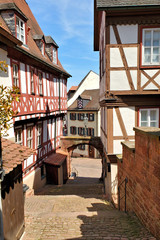 Wall Mural - Narrow stepped street with traditional half timbered buildings in the town of Miltenberg, Bavaria, Germany