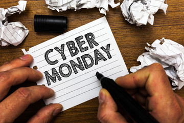 Text sign showing Cyber Monday. Conceptual photo Marketing term for Monday after thanksgiving holiday in the US Man holding marker notebook page crumpled papers several tries mistakes