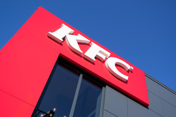 SPIJKENISSE, THE NETHERLANDS - JULY 2, 2019: KFC sign at fast food restaurant. Kentucky Fried Chicken (KFC) is the world's second largest restaurant chain with almost 20,000 locations globally.