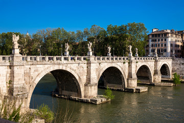 ROME, ITALY - APRIL, 2018: Sant Angelo Bridge over the Tiber River completed in 134 AD by the Emperor Hadrian