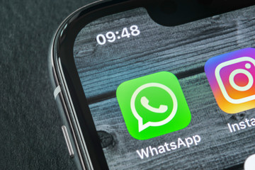 Sankt-Petersburg, Russia, April 11, 2018: Whatsapp messenger application icon on Apple iPhone X smartphone screen close-up. Whatsapp messenger app icon. Social media icon. Social network