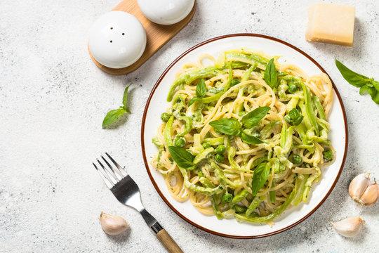 Pasta spaghetti with zucchini top view.