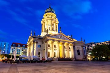 New Church (Deutscher Dom or Neue Kirche) on Gendarmenmarkt square at night, Berlin, Germany