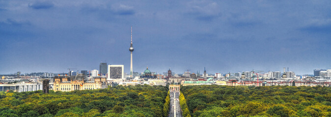 Beautiful panoramic aerial HDR image of the skyline of Berlin including its mail attraction: the Reichstag, Brandenburg Gate, Tv Tower in Alexanderplatz, Berlin Cathedral and Tiergarten