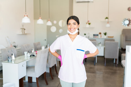 Self-Assured Salon Worker Smiling In Uniform